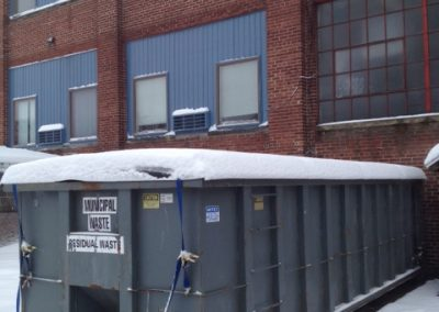Dumpster Gard in action showing it's ability to not buckle under the weight of snow.